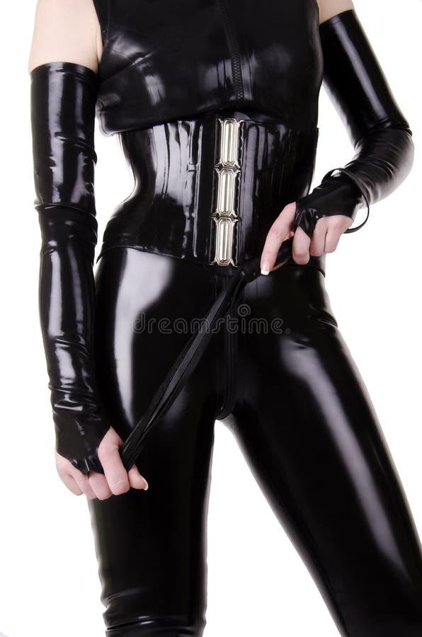 Kobieta ubierająca w dominatrix odziewa fotografia royalty free