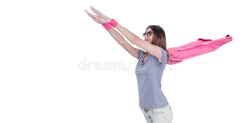 Kobieta udaje latać w bohatera kostiumu fotografia stock
