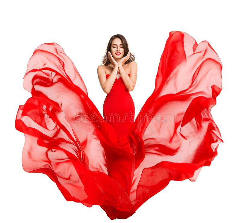 Kobieta Uroda twarzy i makijaż, Czerwona sukienka lecąca na wietrze, modelka mody w falującej sukni obraz royalty free