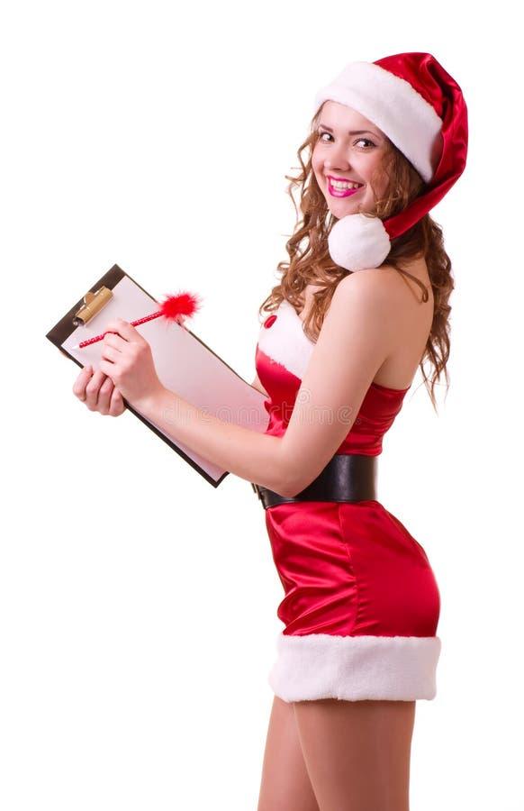 Kobieta w Święty Mikołaj ubraniach opiera na puste miejsce desce obrazy royalty free