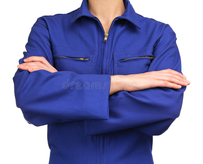 Kobieta w błękitnym praca mundurze z rękami krzyżować fotografia royalty free