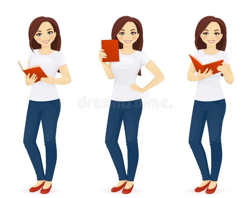 Kobieta w cajgach z książką ilustracji