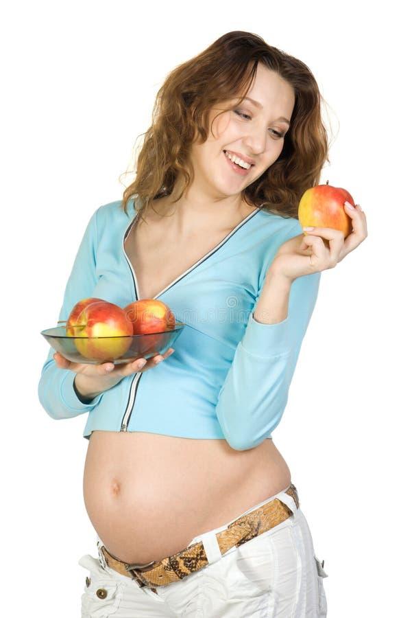 kobieta w ciąży jabłek obraz stock