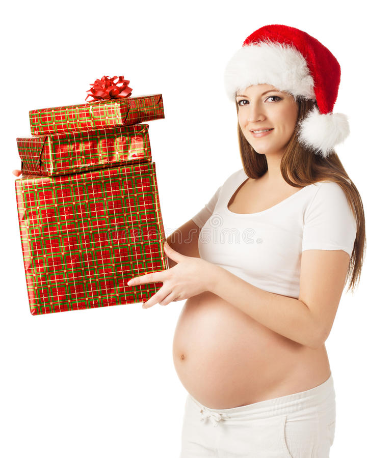 Kobieta w ciąży w Santa mienia teraźniejszości kapeluszowym fift boksuje nad białym tłem zdjęcie royalty free