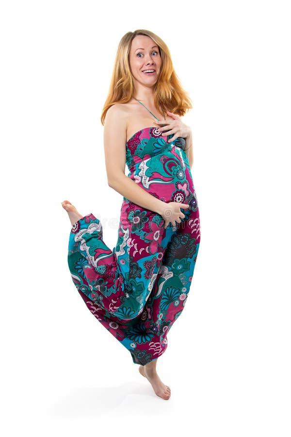 Kobieta w ciąży z brzuszka doskakiwaniem obraz royalty free