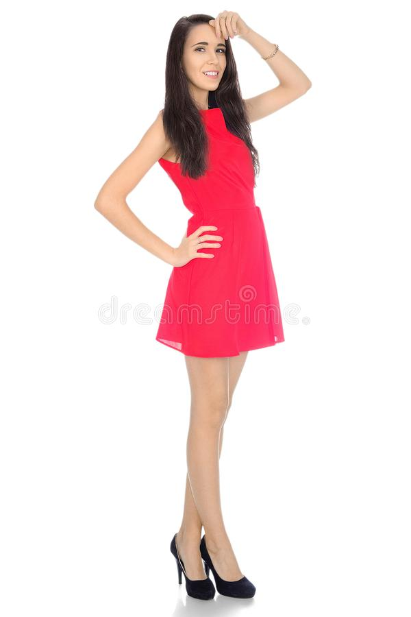 Kobieta w czerwień skrótu piętach i sukni fotografia royalty free