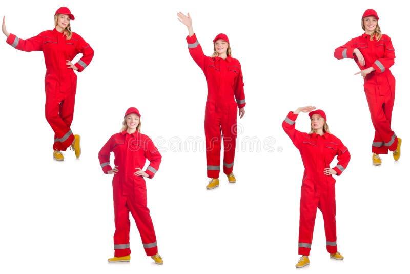 Kobieta w czerwonych kombinezonach na bielu fotografia stock
