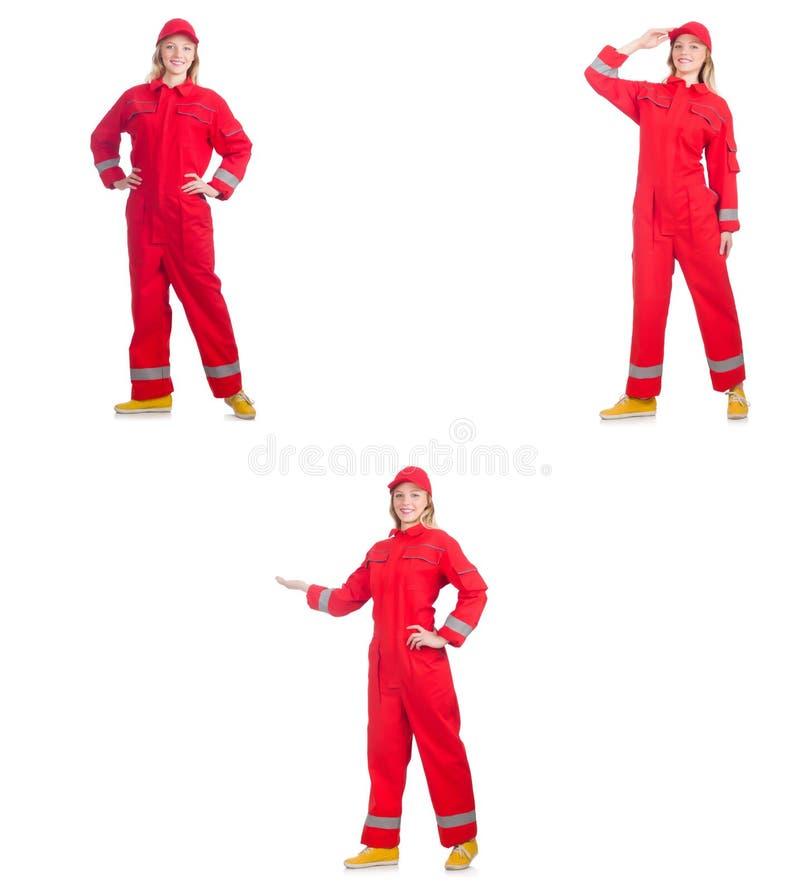 Kobieta w czerwonych kombinezonach na bielu obraz royalty free