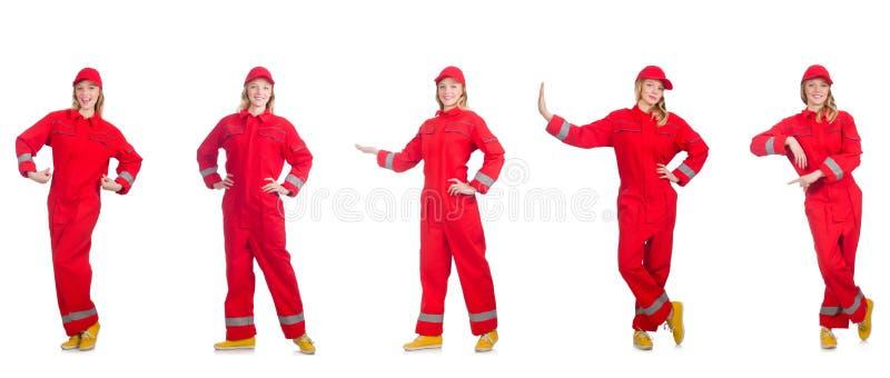 Kobieta w czerwonych kombinezonach na bielu obrazy stock