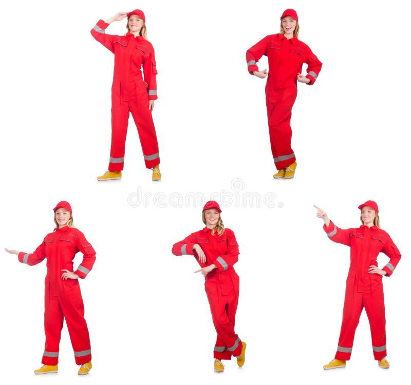 Kobieta w czerwonych kombinezonach odizolowywających na bielu fotografia royalty free