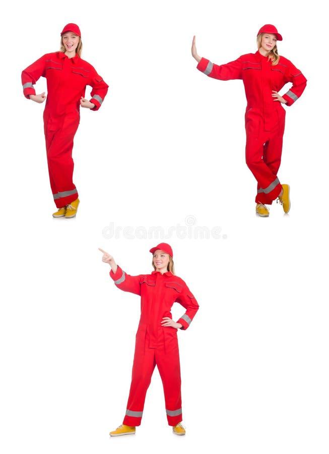 Kobieta w czerwonych kombinezonach odizolowywających na bielu fotografia stock