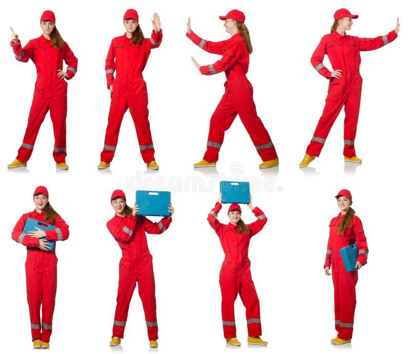 Kobieta w czerwonych kombinezonach odizolowywających na bielu obrazy stock