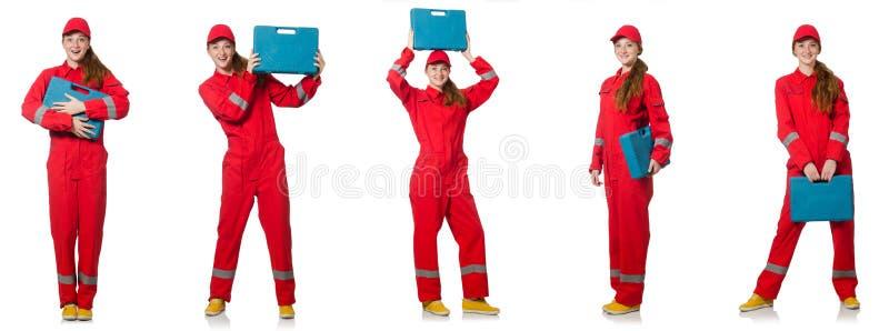 Kobieta w czerwonych kombinezonach odizolowywających na bielu obraz royalty free