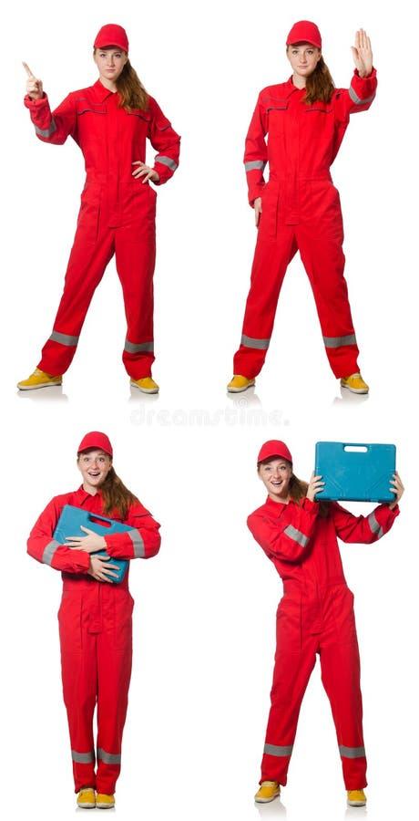 Kobieta w czerwonych kombinezonach odizolowywających na bielu obrazy royalty free