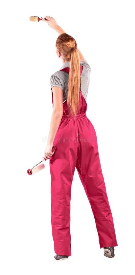Kobieta w czerwonym kombinezonie zdjęcie stock