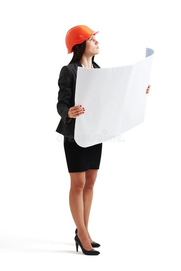 Kobieta w hardhat mienia projekcie zdjęcia stock
