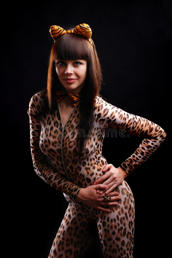 Kobieta w jarzębatym catsuit fotografia royalty free