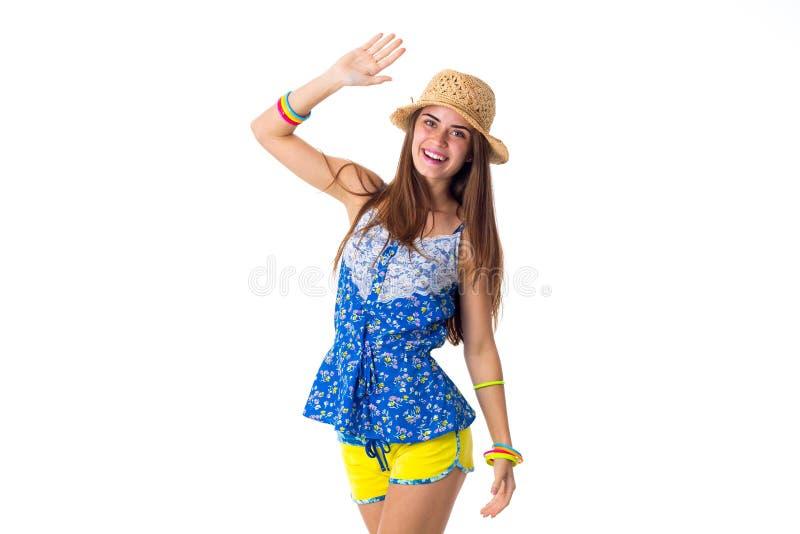 Kobieta w kapeluszowej mienie ręce up zdjęcie royalty free