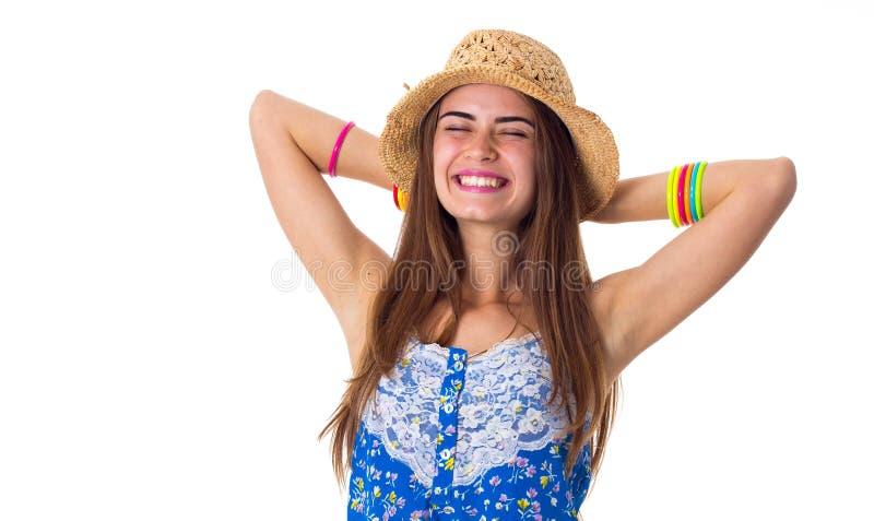 Kobieta w kapeluszowych mienie rękach na głowie obrazy royalty free