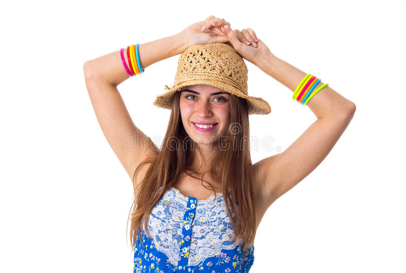 Kobieta w kapeluszowych mienie rękach na głowie zdjęcia stock