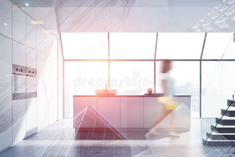 Kobieta w nowożytnym białym kuchennym wnętrzu zdjęcie royalty free