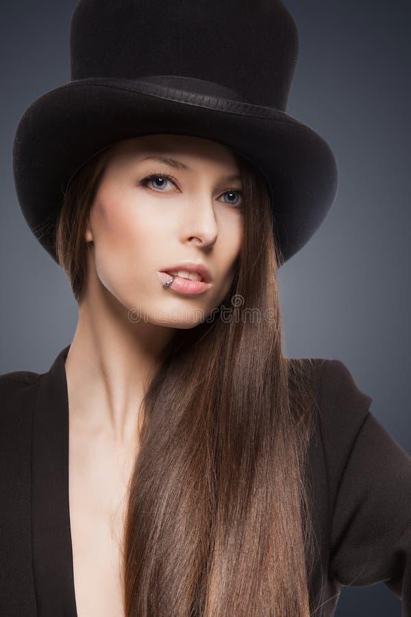 Kobieta w odgórnym kapeluszu obrazy stock