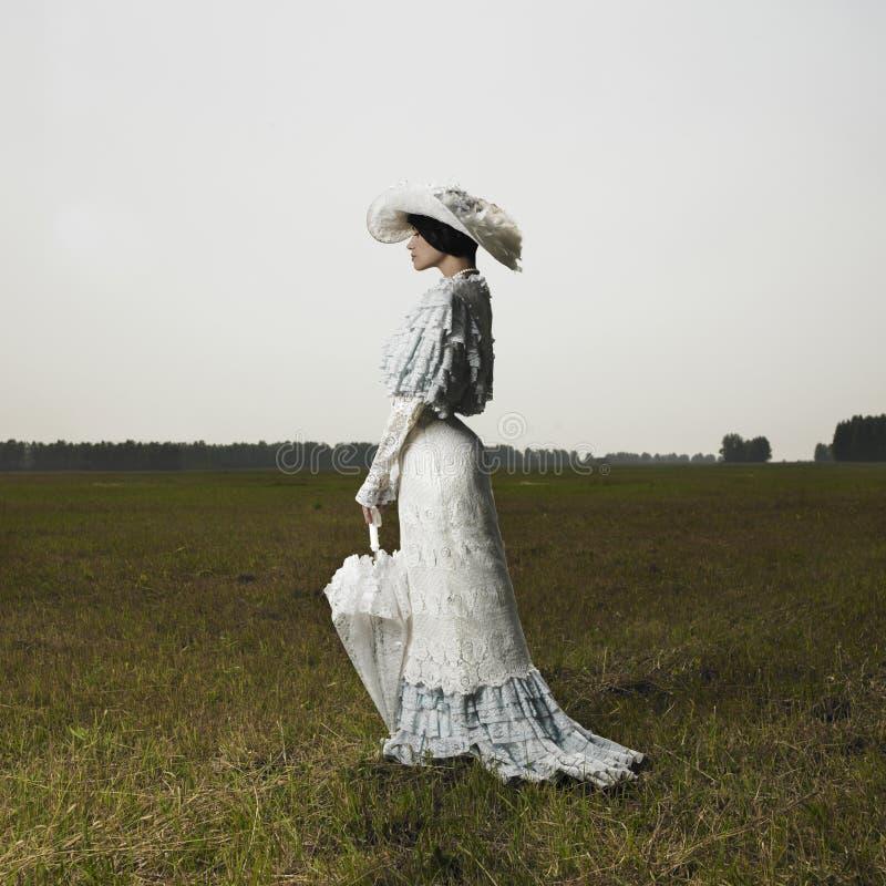 Kobieta w rocznik sukni obrazy royalty free