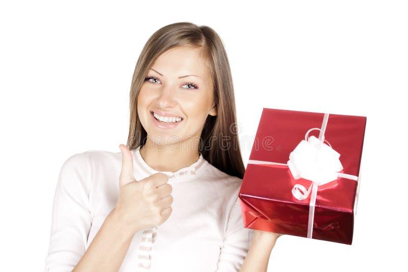 Kobieta w Santa kapeluszowym mienia bożych narodzeń prezencie zdjęcia royalty free