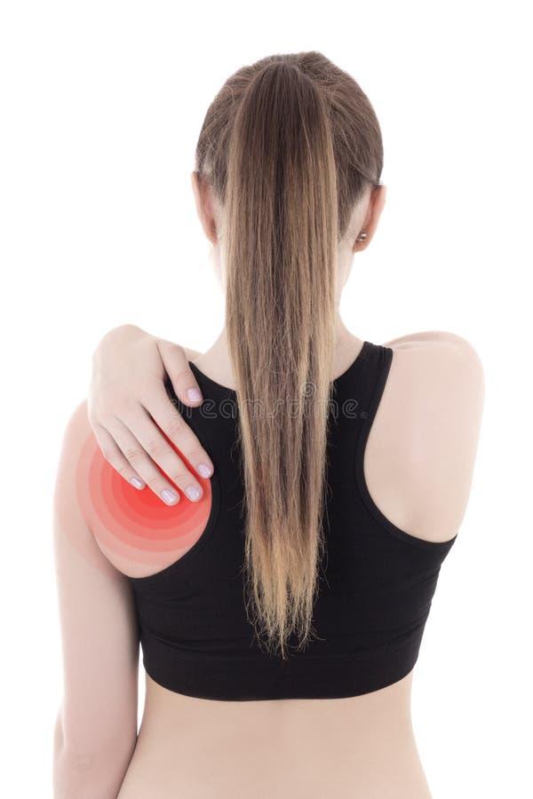 Kobieta w sportswear z bólem w ona z powrotem odizolowywałam na bielu fotografia stock