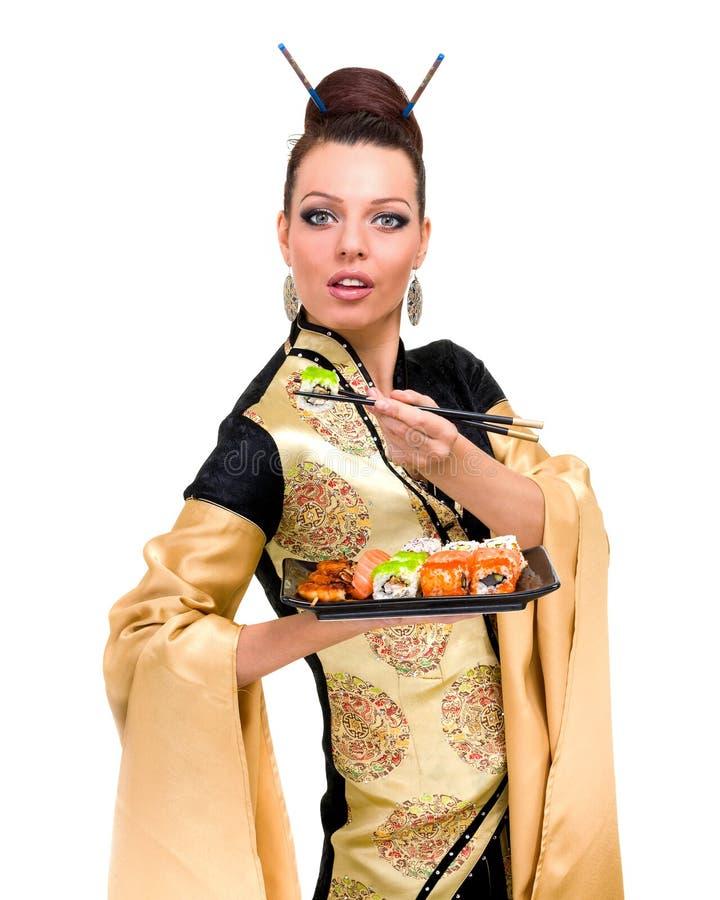Kobieta w tradycyjnej sukni z wschodnim jedzeniem zdjęcia stock