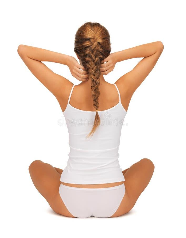 Kobieta w undrewear joga lotosu ćwiczy pozie obraz stock