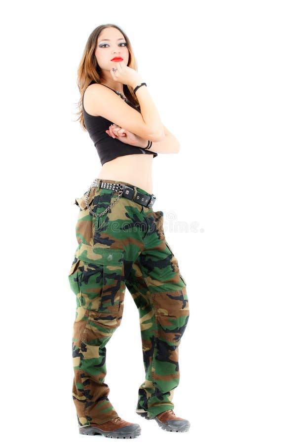 Kobieta w wojskowych ubraniach, biały tło fotografia stock