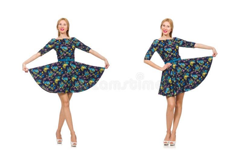 Kobieta w zmroku - b??kitna kwiecista suknia odizolowywaj?ca na bielu zdjęcie royalty free
