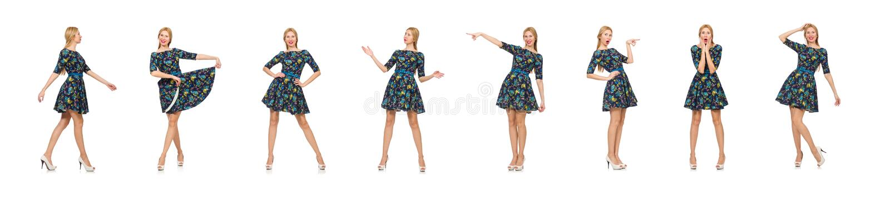 Kobieta w zmroku - b??kitna kwiecista suknia odizolowywaj?ca na bielu fotografia stock