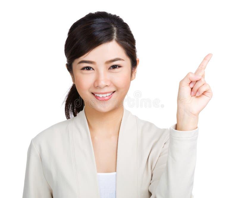 Kobieta wskazuje jeden zdjęcia stock