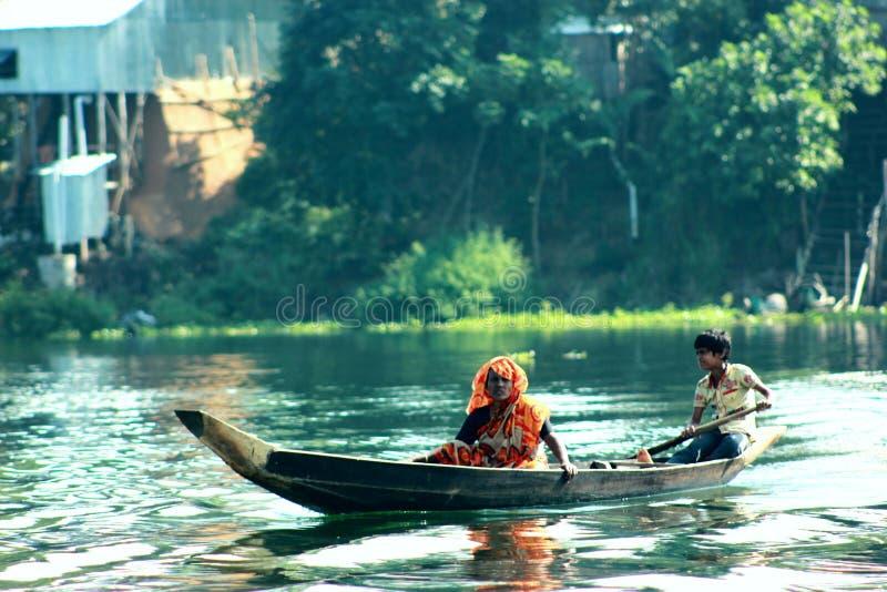 Kobieta z łodzią obrazy royalty free