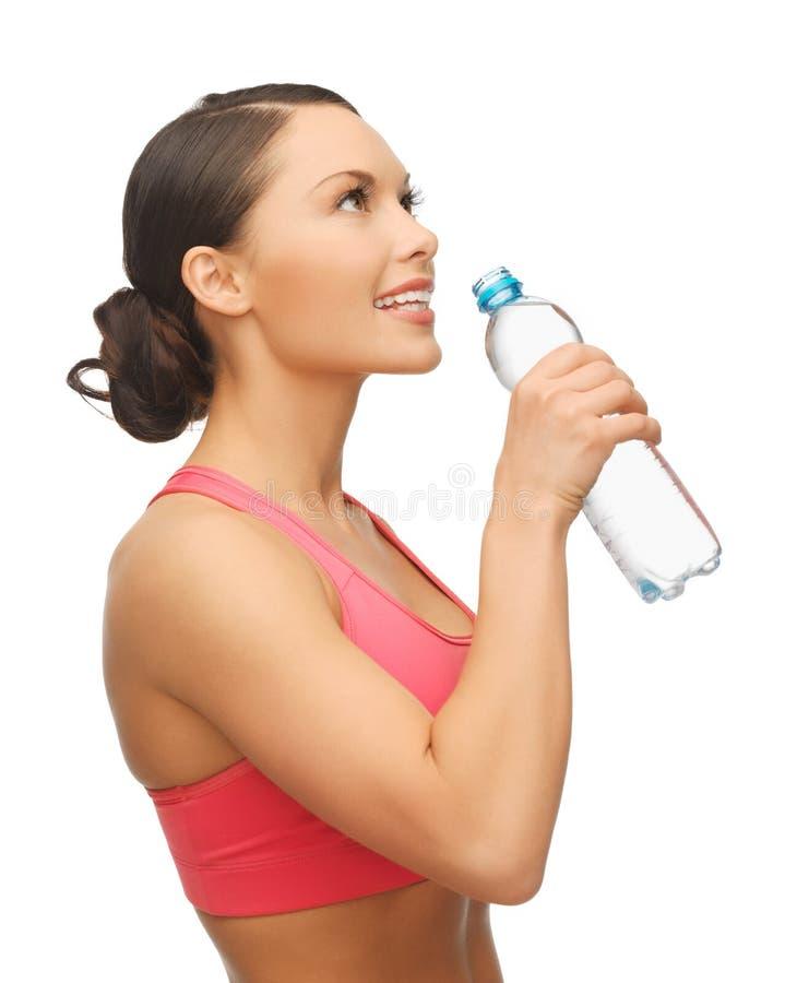Kobieta z butelką woda fotografia royalty free