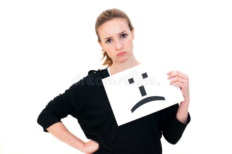 Kobieta z deskowym smutnym emoticon twarzy znakiem zdjęcia stock