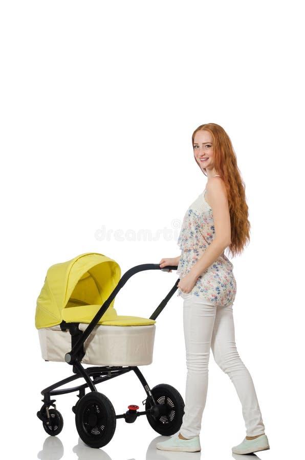 Kobieta z dzieckiem i pram na bielu obrazy royalty free