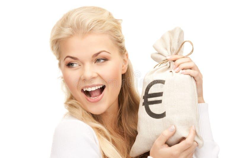 Kobieta z euro podpisującą torbą zdjęcie stock