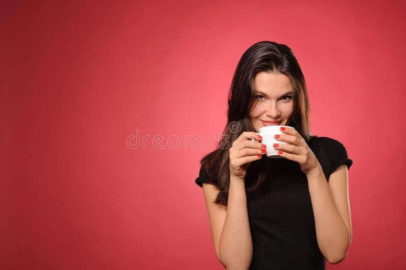Kobieta z filiżanką kawy zdjęcie stock