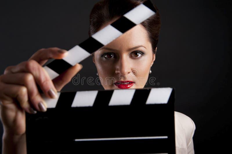 Kobieta z filmu klaśnięcia zakończeniem up zdjęcia stock