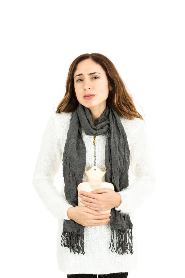 Kobieta z gorącej wody butelką zdjęcie royalty free