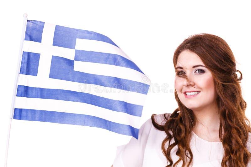 Kobieta z grecką falowanie flaga na bielu, zdjęcia stock