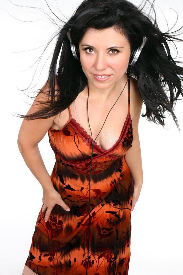 Kobieta z hełmofonami zdjęcie royalty free