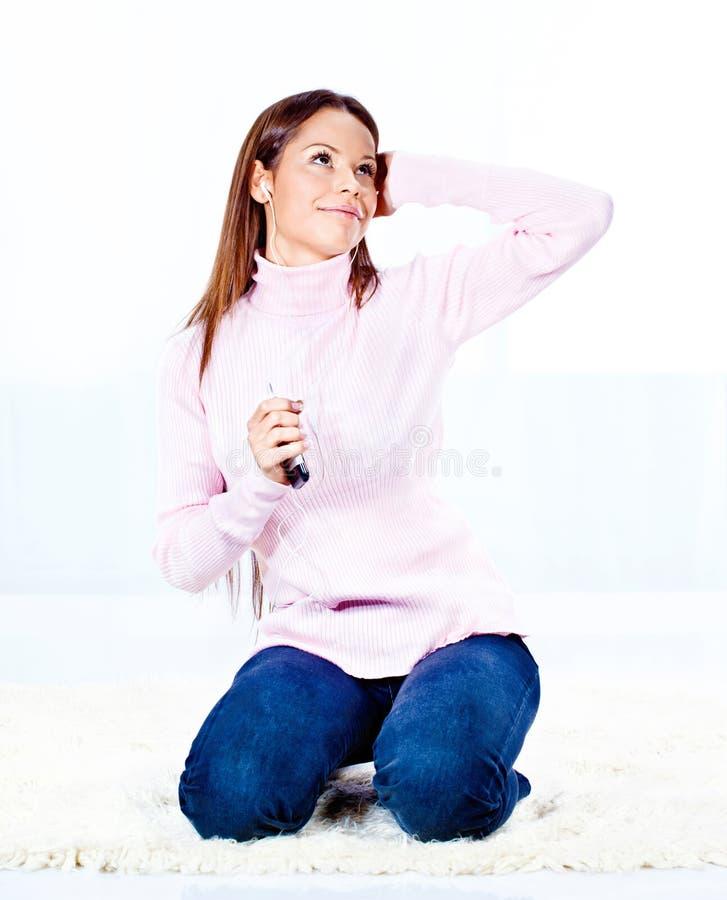 Kobieta z hełmofonami obrazy royalty free