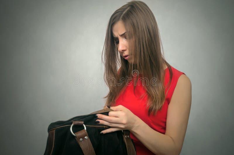 Kobieta z kiesy torbą zdjęcia stock