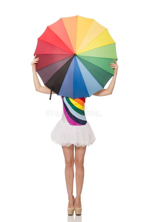 Kobieta z kolorowym parasolem na bielu obraz stock