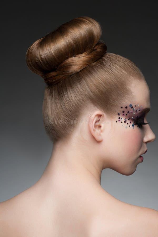 Kobieta z makeup i fryzurą zdjęcia stock