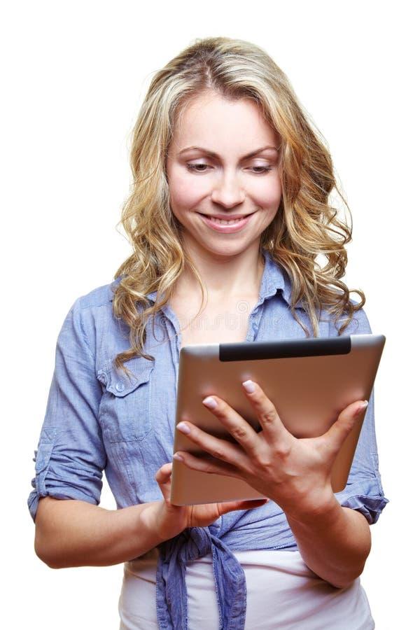 Kobieta z pastylka komputerem fotografia royalty free
